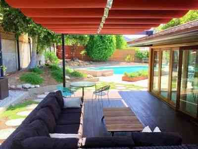 Backyard pool with red slide wire canopies