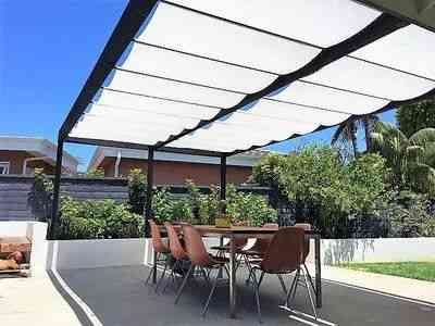 White fabric retractable canopies