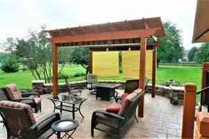 Wood pergola with canopies and outdoor blinds