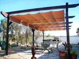 Backyard pergola with tan shades
