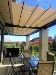 Backyard fabric retractable canopies on slide wire