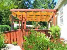Home deck with retractable fabric awnings
