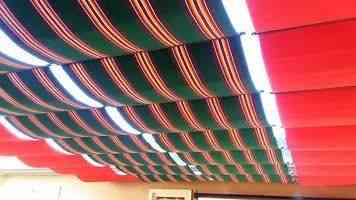 Red and green fabric shades on cables