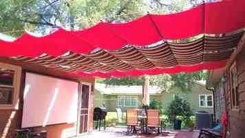 Fabric retractable awnings on slide wires