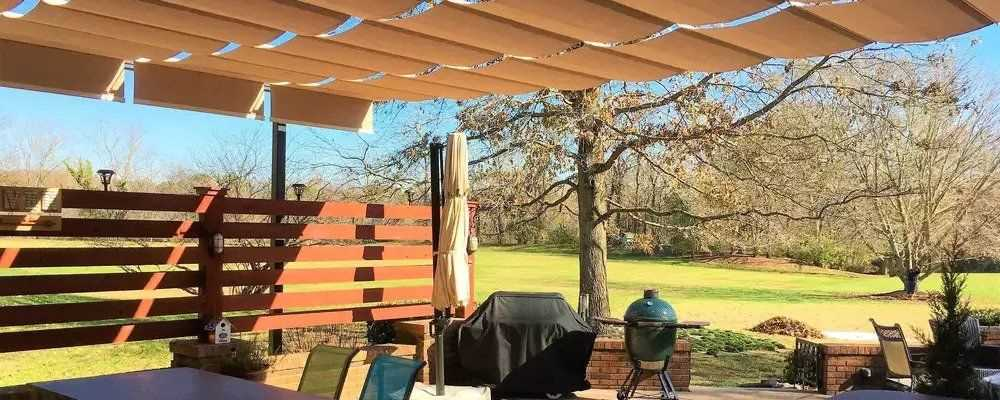 Backyard patio with retractable shades on slide wire