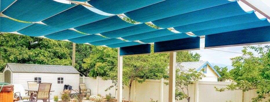 Turquoise blue fabric retractable awnings on slide wire