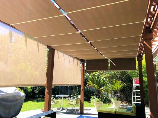 Pergola with drop down outdoor fabric blinds