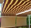 Striped fabric outdoor shades and drop down blinds