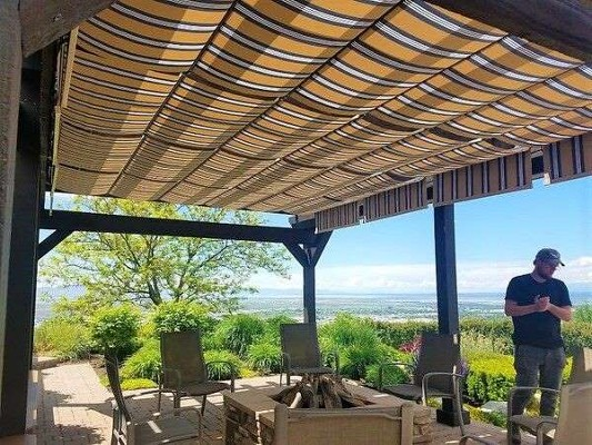 Pergola with added fabric retractable canopies