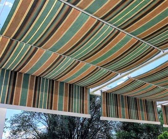 Striped fabric retractable canopies