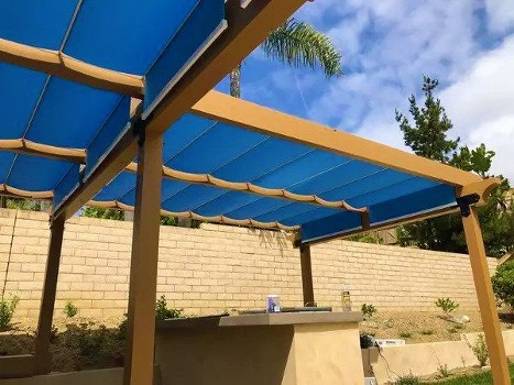 Blue fabric retractable awnings on cables